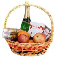 Fruit basket with candy and champagne - flowers and bouquets on 7roz.lviv.ua